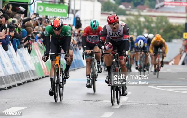Alexander Kristoff of Norway and UAE Team Emirates celebrates winning ahead of Phil Bauhaus of Germany and Team Bahrain Victorious green points...