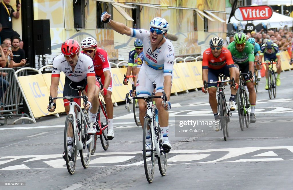 Alexander Kristoff of Norway and UAE Team Emirates wins in front of John Degenkolb of Germany and Trek Segafredo (left) stage 21 of Le Tour de France 2018 between Houilles and Paris - avenue des Champs-Elysees (116 km) on July 29, 2018 in Paris, France.