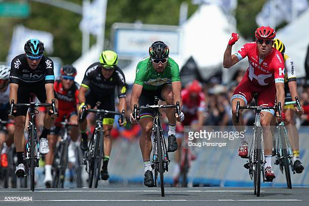 Alexander Kristoff of Norway riding for Team Katusha celebrates his victory ahead of Peter Sagan of Slovakia riding for Tinkoff in second place and...