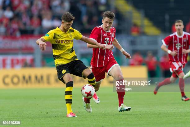 Alexander Laukart of Dortmund and Adrian Fein of Munich battle for the ball during the U19 German Championship Final match between U19 Borussia...