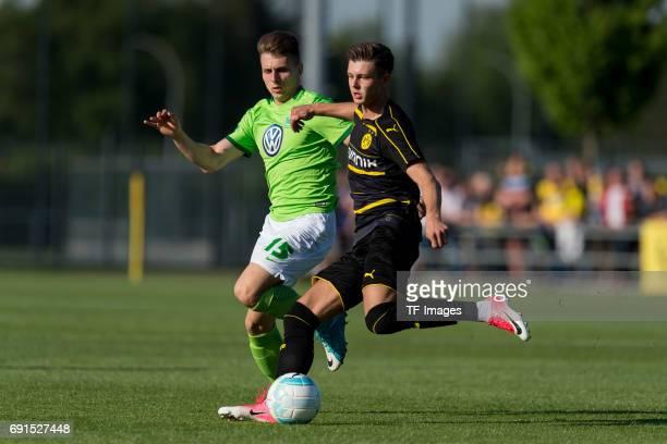 Alexander Laukart of Dortmund and Yannik Moeker of Wolfsburg battle for the ball during the U19 German Championship Semi Final second leg match...