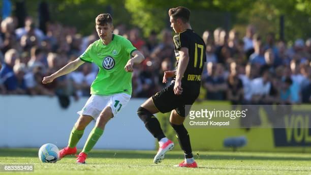 Alexander Laukart of Dortmund challenges David Nieland of Wolfsburg during the U19 German Championship Semi Final second leg match between Borussia...