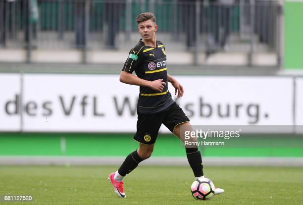 Alexander Laukart of Dortmund runs with the ball during the AJuniors German Championship semi final first leg match between VfL Wolfsburg and...