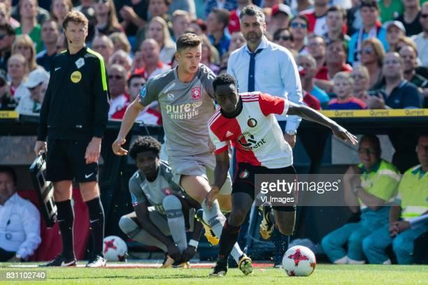 Alexander Laukart of FC Twente Ridgeciano Haps of Feyenoord during the Dutch Eredivisie match between Feyenoord Rotterdam and FC Twente at the Kuip...