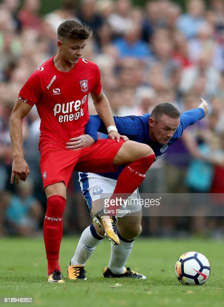 Alexander Laukart of Twente challenges Wayne Rooney of Everton during a preseason friendly match between FC Twente and Everton FC at Sportpark de...