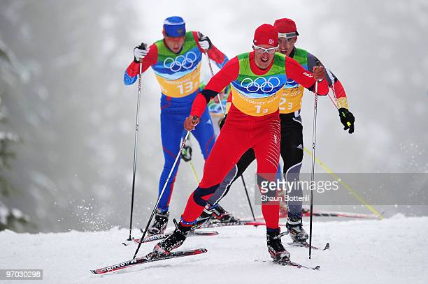 Alexander Legkov of Russia Lars Berger of Norway and Rene Sommerfeldt of Germany ski in the Free style during the third leg of the cross country...