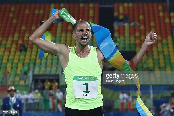 Alexander Lesun of Russia celebrates as he crosses the finish line to win gold in the Modern Pentathlon on Day 15 of the Rio 2016 Olympic Games at...