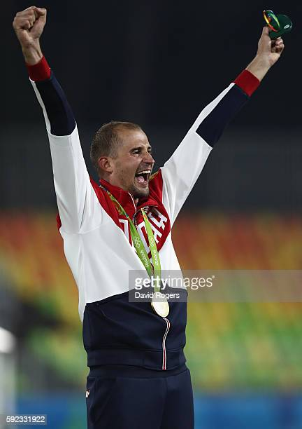 Alexander Lesun of Russia celebrates on the podium after being presented with his gold medal for the Modern Pentathlon on Day 15 of the Rio 2016...