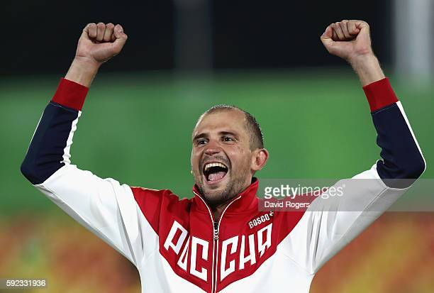 Alexander Lesun of Russia celebrates on the podium befor being presented with his gold medal for the Modern Pentathlon on Day 15 of the Rio 2016...