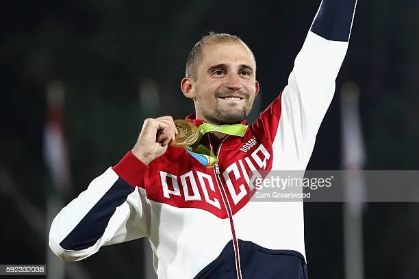 Alexander Lesun of Russia celebrates on the podium with his gold medal for the Modern Pentathlon on Day 15 of the Rio 2016 Olympic Games at Deodoro...