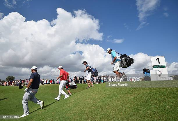 Alexander Levy of France and Felipe Aguilar of Chile walk on the first hole during the final round of the Portugal Masters at Oceanico Victoria Golf...