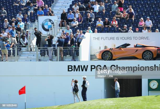 Alexander Levy of France and Rafa Cabrera Bello of Spain take part in a stunt as they play from the grandstand during the BMW PGA Championship Pro Am...