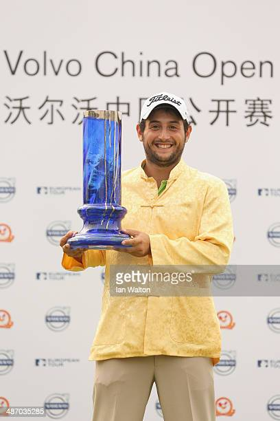 Alexander Levy of France celebrates with the trophy after winning the 2014 Volvo China Open at Genzon Golf Clubat Genzon Golf Club on April 27 2014...