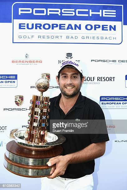 Alexander Levy of France holds the trophy after wining in the final round of the Porsche European Open at Golf Resort Bad Griesbach on September 25...
