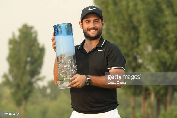 Alexander Levy of France holds the trophy celebrates after winning the 2017 Volvo China Open at Topwin Golf and Country Club on April 30 2017 in...