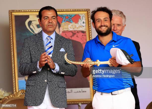 Alexander Levy of France is presented with the winners trophy by HRH Prince Moulay Rachid of Morocco after the final round of the Trophee Hassan II...