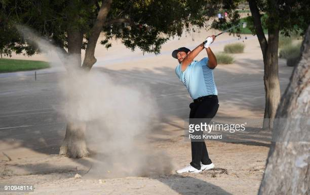 Alexander Levy of France plays his second shot on the 16th hole during day three of Omega Dubai Desert Classic at Emirates Golf Club on January 27...