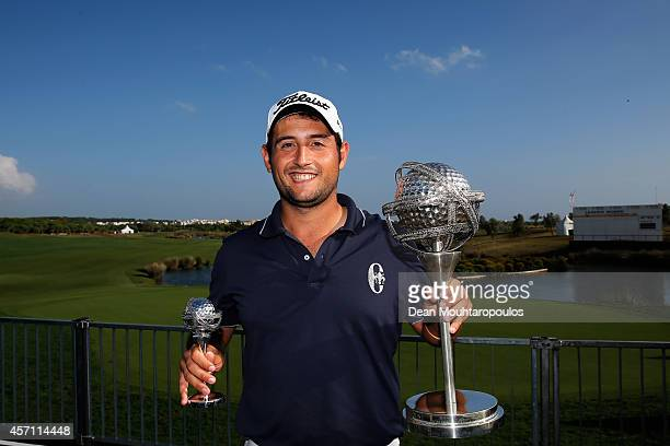 Alexander Levy of France poses with the trophy and the smaller take home replica trophy after winning the Portugal Masters at the Oceanico Victoria...