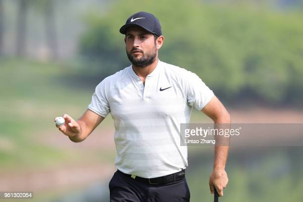 Alexander Levy of France waves his ball to the fans during the first round of the 2018 Volvo China Open at Topwin Golf and Country Club on April 26...