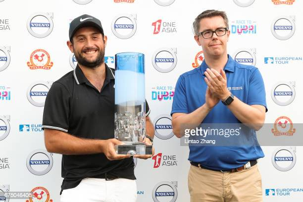 Alexander Levy of France with Sven De Smet Volvo Marketing Vice President celebrates after winning the 2017 Volvo China Open at Topwin Golf and...