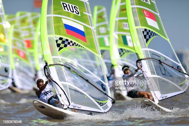 Alexander Lim of Singapore and Egor Zhilin of Russia in Men's WindsurferTechno 293 during day 1 of Buenos Aires 2018 Youth Olympic Games at Club...