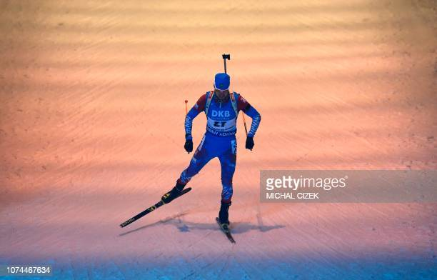 Alexander Loginov of Russia competes during the Men's 10Km sprint competition of IBU World Cup Biathlon in Nove Mesto Czech Republic on December 20...