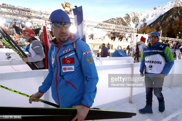 Alexander Loginov of Russia is escorted by a official after the Men 4x7.5 km Relay Competition at the IBU World Championships Biathlon...