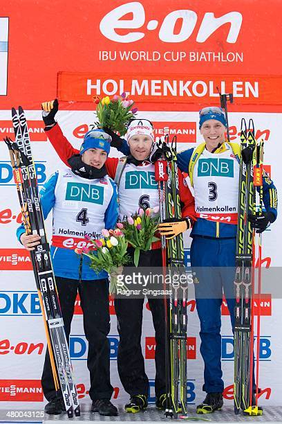 Alexander Loginov of Russia takes second place Simon Eder of Austria takes first place and Bjoern Ferry of Sweden takes third place during the IBU...