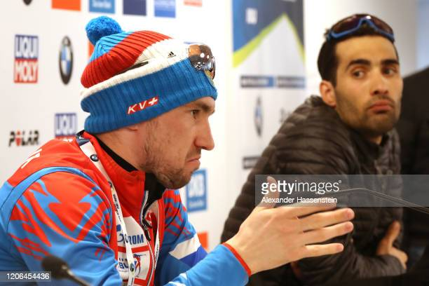 Alexander Loginov of Russia talks to the media next to Martin Fourcade of France during a press conference after the Men 10 km Sprint Competition at...