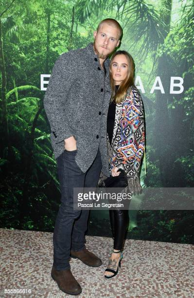 Alexander Ludwig and a guest attend the Elie Saab show as part of the Paris Fashion Week Womenswear Spring/Summer 2018 on September 30 2017 in Paris...