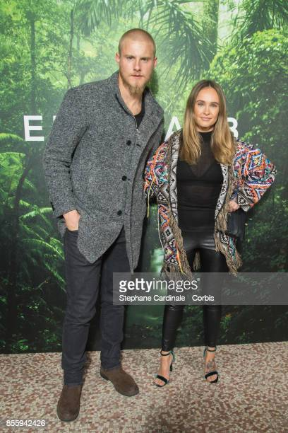 Alexander Ludwig and a guest attend the Elie Saab show as part of the Paris Fashion Week Womenswear Spring/Summer 2018 at on September 30 2017 in...