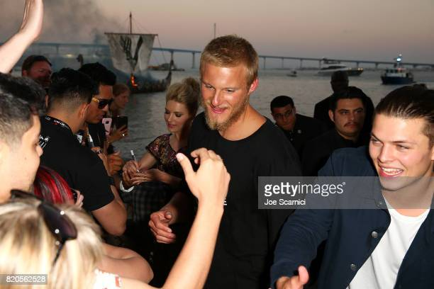 Alexander Ludwig and Alex Hogh Andersen of HISTORY'S 'Vikings' attend the Viking Funeral Ceremony at San Diego Comic Con 2017 on July 21 2017 in San...