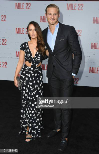 Alexander Ludwig and Kristy Dawn Dinsmore attend the premiere of STX Films' Mile 22 at Westwood Village Theatre on August 9 2018 in Westwood...
