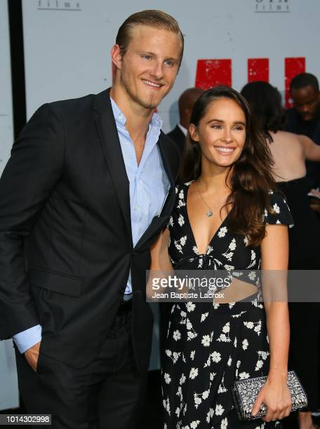 Alexander Ludwig and Kristy Dawn Dinsmore attend the premiere of STX Films' 'Mile 22 at Westwood Village Theatre on August 9 2018 in Westwood...