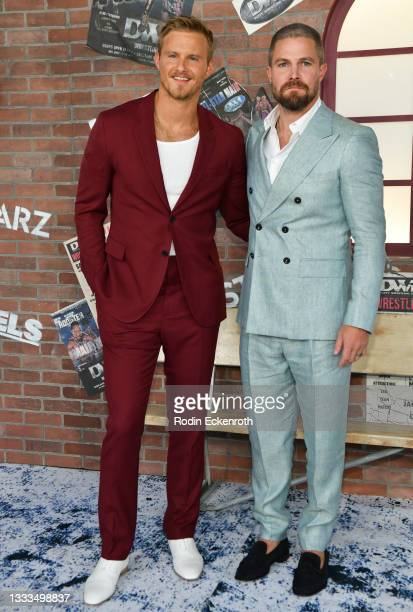 """Alexander Ludwig and Stephen Amell attend the STARZ premiere of new series """"Heels"""" on August 10, 2021 in Los Angeles, California."""