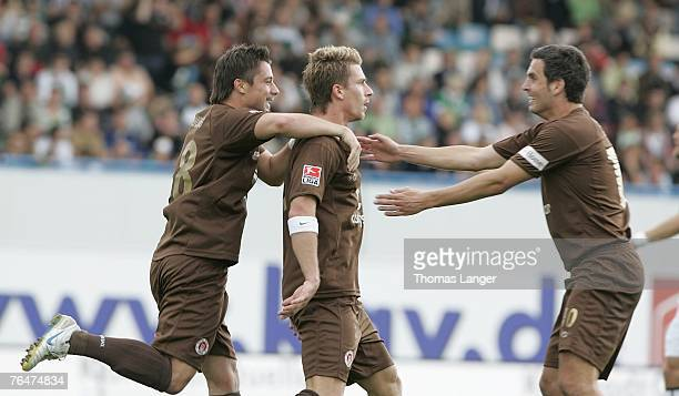 Alexander Ludwig; Marvin Braun and Thomas Meggle of St Pauli celebrate after Brauns first goal during the 2. Bundesliga match between SpVgg Greuther...
