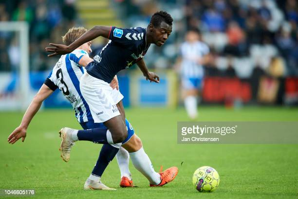 Alexander Ludwig of OB Odense and Mustapha Bundu of AGF Arhus compete for the ball during the Danish Superliga match between OB Odense and AGF Arhus...