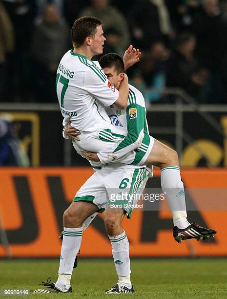 Alexander Madlung and Jan Simunek of Wolfsburg celebrate after winning the Bundesliga match between VfL Wolfsburg and FC Schalke 04 at Volkswagen...
