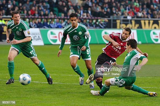 Alexander Madlung and Ricardo Costa of Wolfsburg, Albert Bunjaku of Nuernberg and Sascha Riether of Wolfsburg in action during the Bundesliga match...