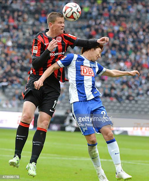 Alexander Madlung of Eintracht Frankfurt and Genki Haraguchi of Hertha BSC during the game between Hertha BSC and Eintracht Frankfurt on may 16, 2015...