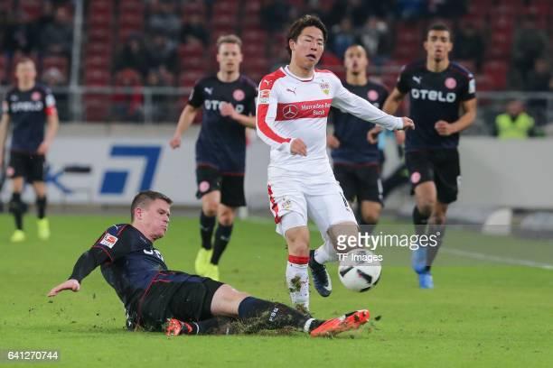 Alexander Madlung of Fortuna Duesseldorf and Takuma Asano of Stuttgart battle for the ball during the Second Bundesliga match between VfB Stuttgart...
