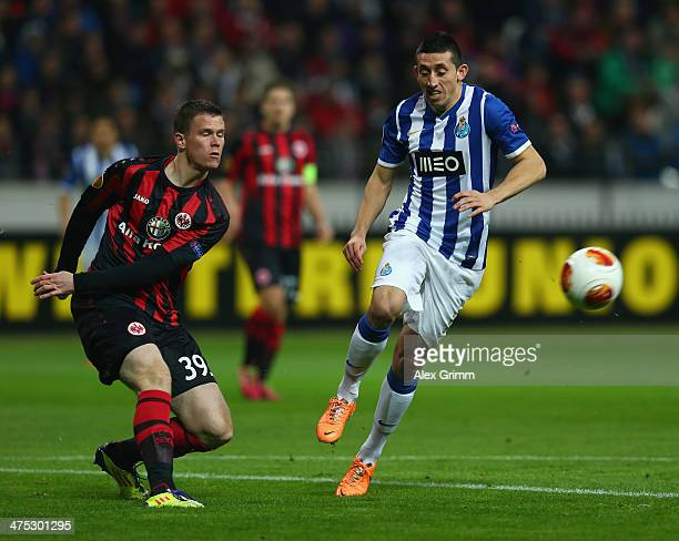 Alexander Madlung of Frankfurt is challenged by Hector Herrera of Porto during the UEFA Europa League Round of 32 second leg match between Eintracht...