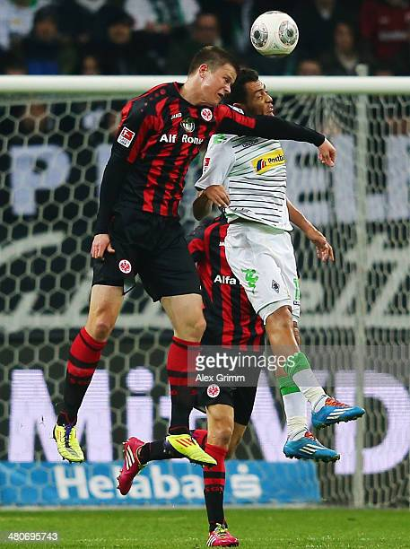 Alexander Madlung of Frankfurt jumps for a header with Juan Arango of Moenchengladbach during the Bundesliga match between Eintracht Frankfurt and...