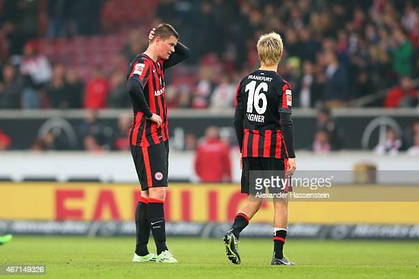 Alexander Madlung of Frankfurt reacts with his team mate Stefan Aigner after the Bundesliga match between VfB Stuttgart and Eintracht Frankfurt at...