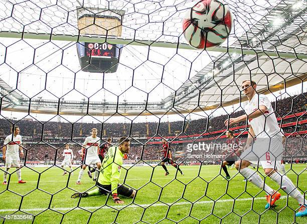 Alexander Madlung of Frankfurt scores his team's first goal against goalkeeper Thorsten Kirschbaum of Stuttgart during the Bundesliga match between...