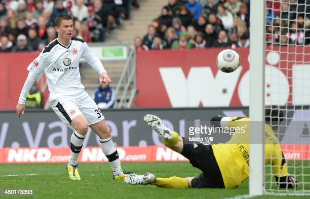 Alexander Madlung of Frankfurt scores his team's third goal during the Bundesliga match between 1. FC Nuernberg and Eintracht Frankfurt at Grundig...
