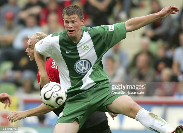 Alexander Madlung of Wolfsburg challenges for the ball with Sergej Barbarez of Leverkusen during the Bundesliga match between Bayer Leverkusen and...