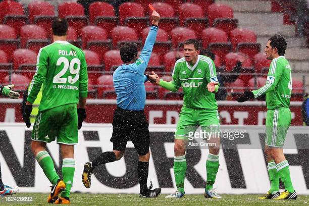 Alexander Madlung of Wolfsburg is sent of Offenbach by referee Peter Sippel during the Bundesliga match between 1. FSV Mainz 05 and VfL Wolfsburg at...