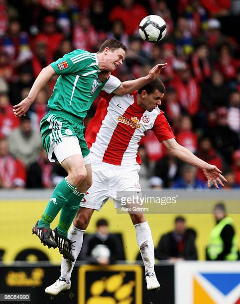 Alexander Madlung of Wolfsburg jumps for a header with Adam Szalai of Mainz during the Bundesliga match between FSV Mainz 05 and VfL Wolfsburg at the...