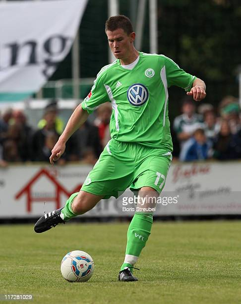 Alexander Madlung of Wolfsburg runs with the ball during the pre-season friendly match between TuS Neudorf-Platendorf and VfL Wolfsburg at '...